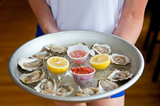 Oysters being served on a platter by Sophie Mac