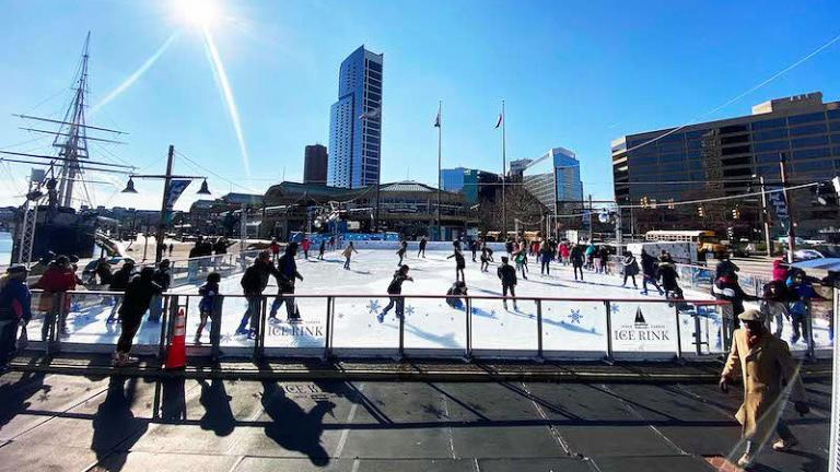 People ice skating at the Inner Harbor Ice Rink in Baltimore