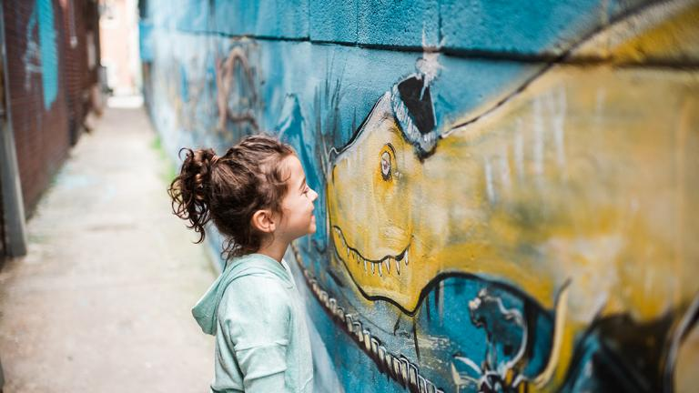 A Young Girl Makes A New Friend on the Public Art Trail