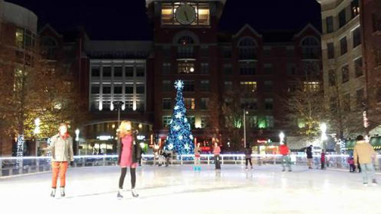 People ice skating at the square in Rockville