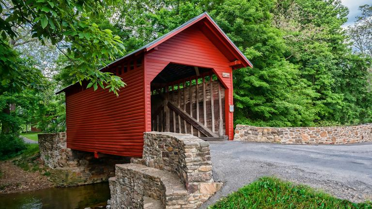 Hop on your bike and see authentic sites like this covered bridge in Frederick Countyy.