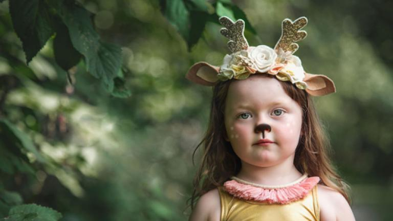 girl wearing woodland creature crown headband