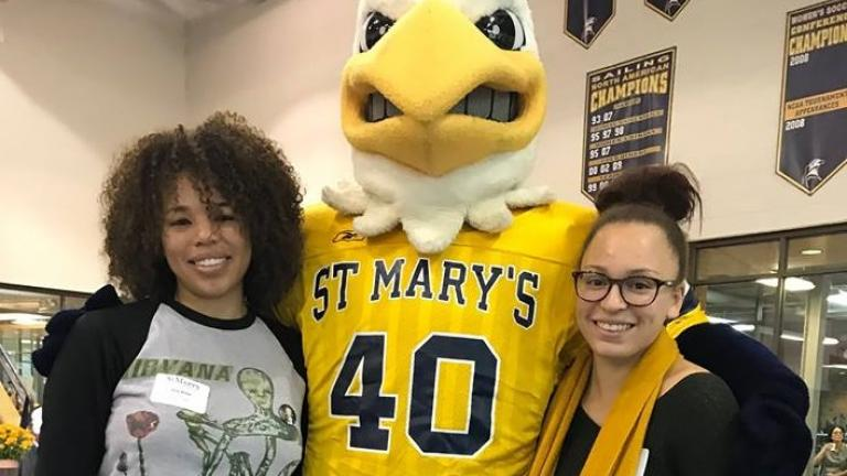 Students posing with mascot