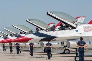 USAF Thunderbirds lined up on flight line.