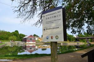 Visitor Center Sign for C and O Canal with Cushwa's Historic Warehouse in Background