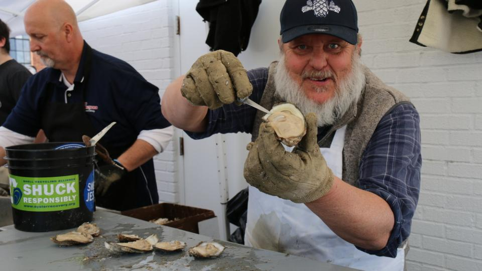 Man Shows Off his Oyster Shucking Skill at the Annapolis Oyster Roast and Sock Burning