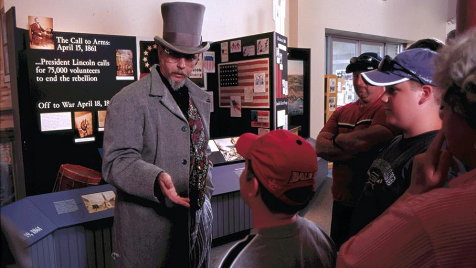 Reenactor speaking to students inside the Baltimore Civil War Museum