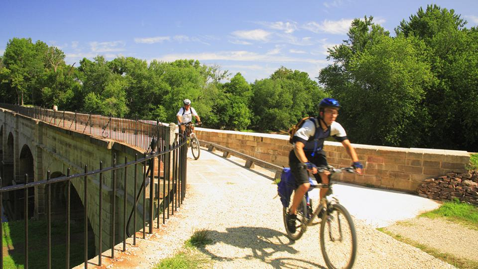 Biking across the Monocacy Aqueduct on the C&O Canal Towpath