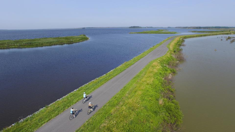 three bikers in waterfront trail