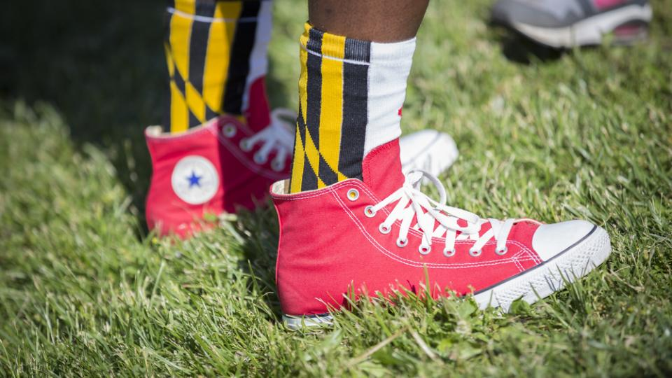 Maryland flag socks and red Converse sneakers