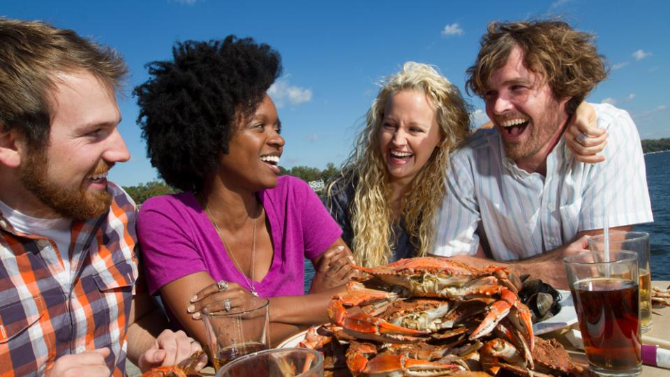 couples laughing over crabs