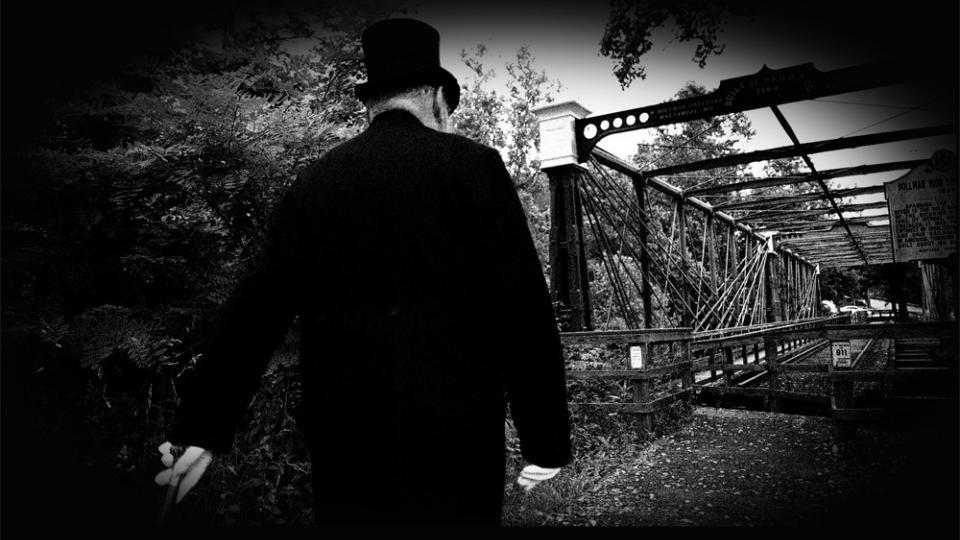 man walking along railroad tracks Halloween Activities