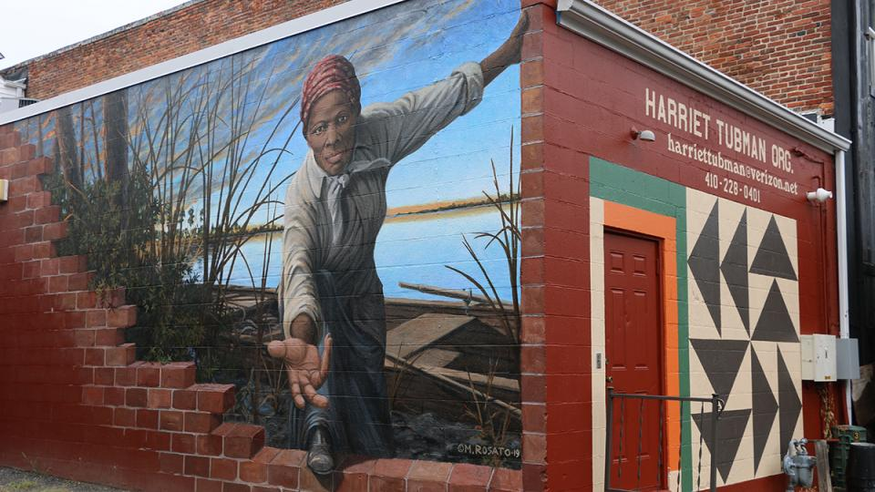Mural of Harriet Tubman with her hands reaching out