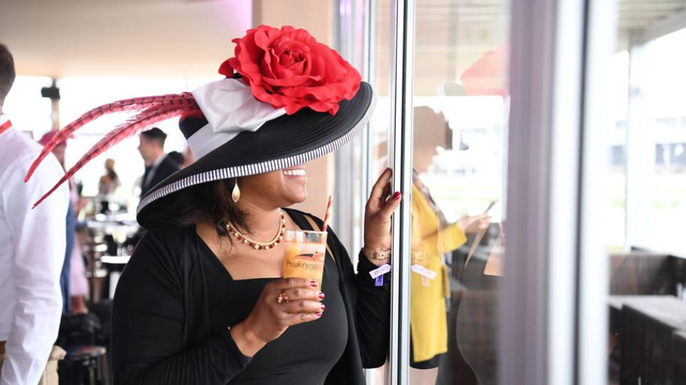 Enjoying a Black-Eyed Susan during the Preakness Stakes