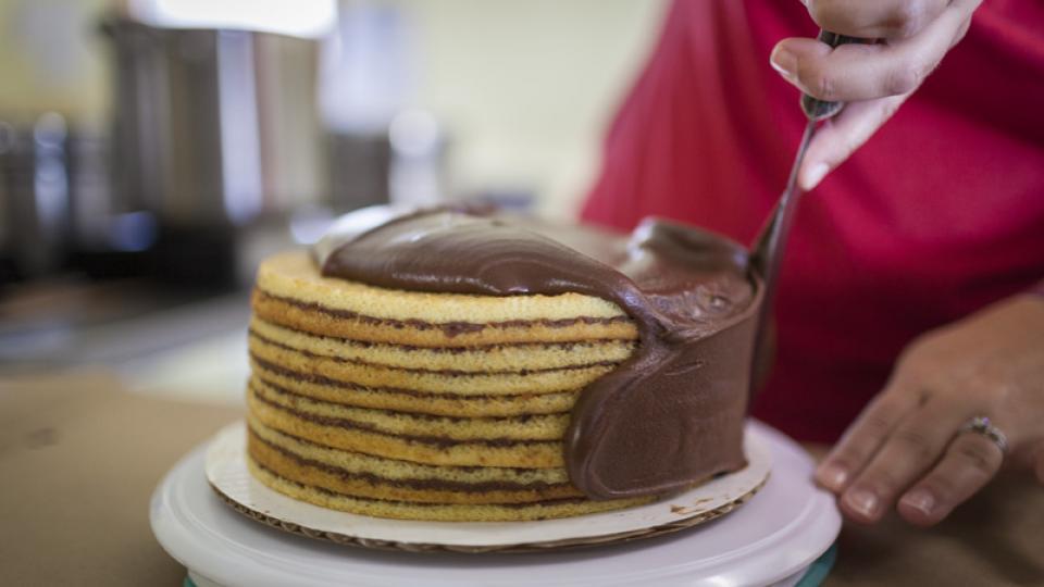 Baker frosting a Smith Island cake.