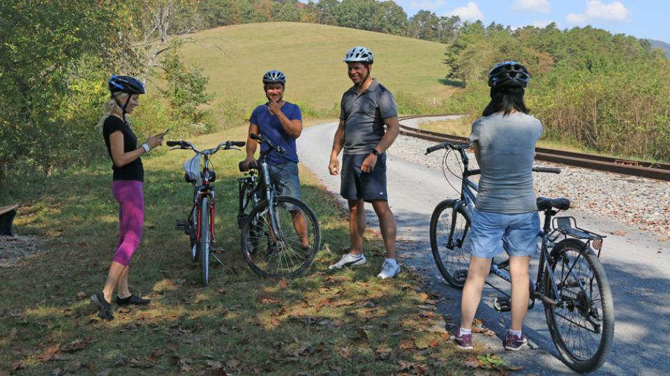 Two women and two men cycling the Great Allegheny Passage together