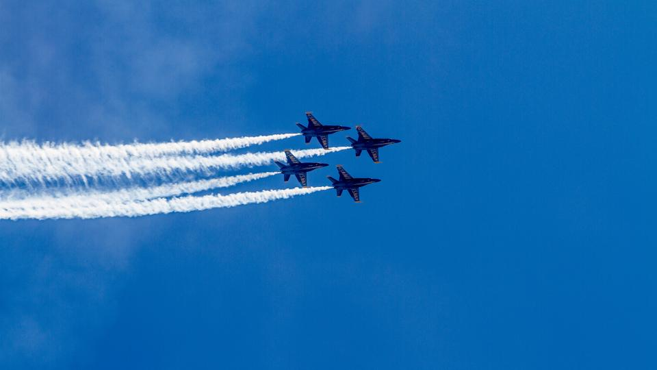 Blue Angels perform in a clear blue sky over Baltimore City.