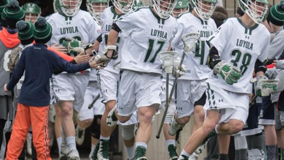 Loyola lacrosse players taking the field