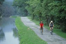 Two men riding bicycles along the C&O Canal Towpath