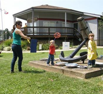 Children's playing at St. Clement's Island Museum Photo