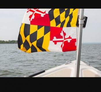 Boat with Maryland Flag Out on the Water Photo
