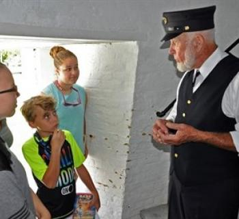 Visitors at the lighthouse with a lighthouse operator Photo