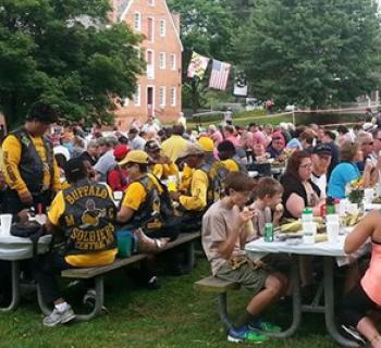 People enjoying all the corn they can eat! Photo