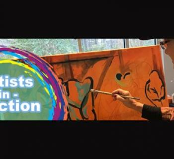 An artist painting at Artists in Action Photo