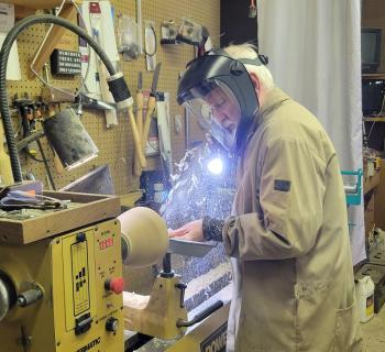 David Swiger turning wood on the lathe Photo