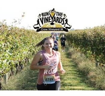 Woman Runs the Crow 5k Through the Vineyard Photo