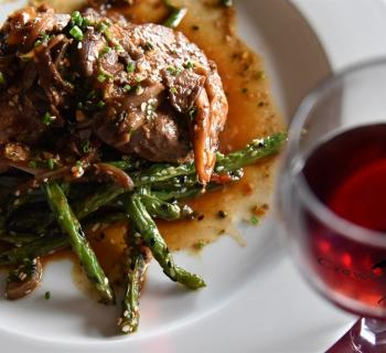 Food on a plate with a glass of red wine  Photo