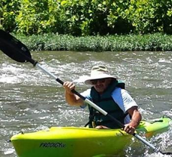 a kayaker enjoying the river Photo
