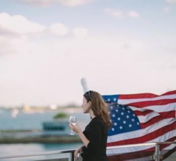 Woman on a boat with American flag background. Photo