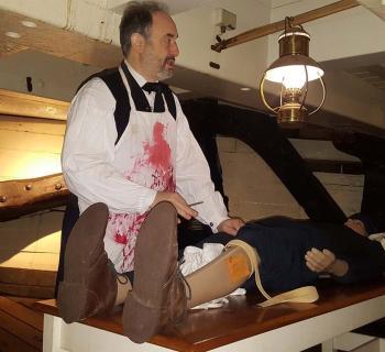 "Surgeon Brad Stone ""treating"" a ""patient"" Photo"