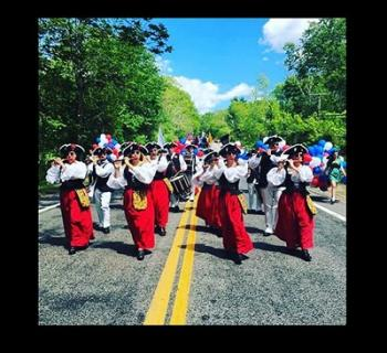 The Bristol County Fifes & Drums performing in a parade formation Photo