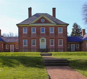 Montpelier Mansion's brick exterior with grass and trees Photo