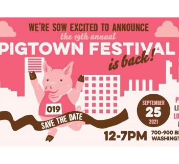 Cartoon Pig runs the race on this pink and white poster announcing the festival. Photo