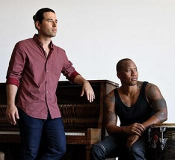 Rodiguez and Martinez pose with piano and drums Photo