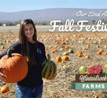 22nd Fall Festival poster of young woman holding pumpkins Photo
