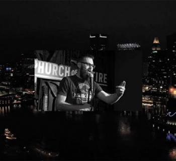 Comedian superimposed on Baltimore's Inner Harbor Photo