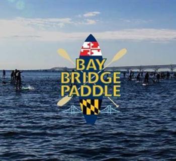 Bay Bridge Paddle logo imposed on photo of Bay Bridge with Paddlers Photo