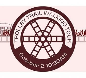 Trail Tour poster with a drawing of a wheel and people on a trail Photo