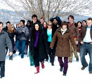 The East Coast Chamber Orchestra walking together in the snow. Photo