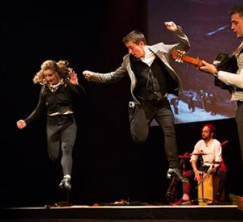 Velocity Irish Dance on stage while musicians play Irish dance songs Photo