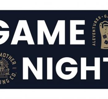 Game Night against black background with two gold game pieces Photo