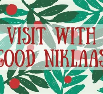Visit with Good Niklaas poster with green leaves and red berries Photo
