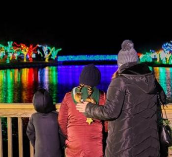 A Family enjoying a view of Winterfest Photo