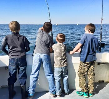 Young fishermen enjoy the waters off Tilghman Island. Photo
