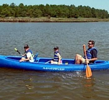 Father and children kayaking Photo