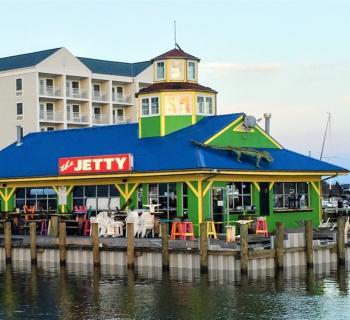Exterior from the water of The Jetty: Restaurant and Dock Bar Photo